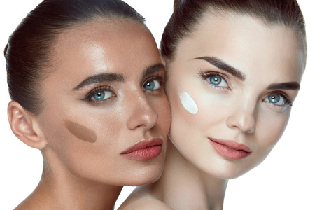 beauty girls: Facial Care. Closeup Of Beautiful Young Women With Different Shades Of Foundation On Face. Portrait Of Attractive Healthy Girls With Perfect Skin And Fresh Makeup. Beauty Cosmetics. High Resolution Stock Photo
