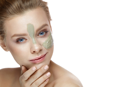 Beauty Cosmetics. Portrait Of Beautiful Healthy Girl Caressing Face On White Background. Closeup Of Sexy Young Woman With Clay Mask Stripes On Perfect Facial Skin. Cosmetic Concept. High Resolution Stok Fotoğraf