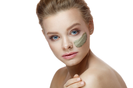 Closeup Of Cosmetic Clay Mask On Beautiful Young Woman Face. Stock Photo