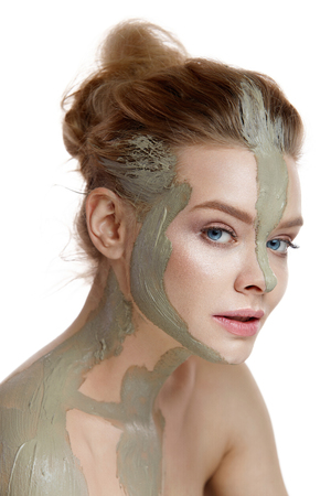 Skin And Body Care. Closeup Of Beautiful Sexy Woman With Cosmetic Clay Mask On Skin. Portrait Of Healthy Young Female With Fresh Natural Makeup. Spa Cosmetics. High Resolution