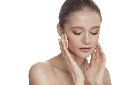 Beauty Cosmetics. Portrait Of Young Beautiful Woman With Powder Cushion Puff Applying Cosmetic Powder On Face. Closeup Young Female Model With Smooth Skin, Fresh Makeup. Facial Care. High Resolution Stock Photo