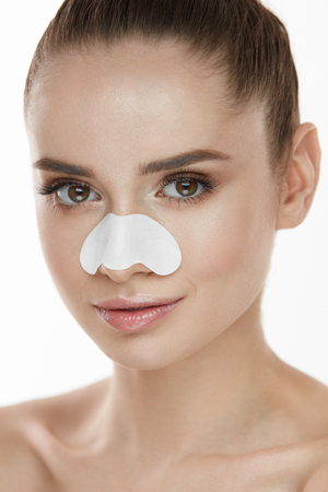 Beautiful Woman Face With Skin Care Patch On Nose. Portrait Of Young Female With Cleansing Pore Strip On Fresh Clean Skin. Closeup Of Sexy Girl With Natural Makeup And Beauty Product. High Resolution Stock Photo - 78817192