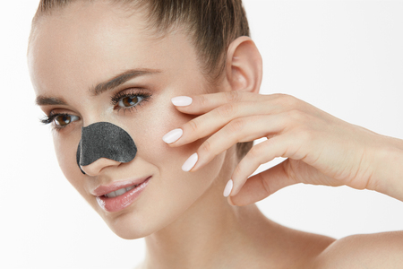 Beautiful Woman With Beauty Face And Skin Care Patch On Nose. Closeup Of Sexy Girl Using Cleansing Strip For Nose. Young Female With Clean Skin, Fresh Makeup On White Background. High Resolution