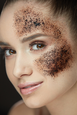 Woman Face Skin Care. Closeup Beautiful Healthy Girl With Fresh Makeup Doing Peeling Procedure. Portrait Of Sexy Young Woman With Natural Coffee Mask, Skin Scrub On Face. Beauty. High Resolution
