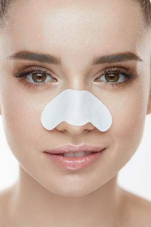Beautiful Woman Face With Skin Care Patch On Nose. Portrait Of Young Female With Cleansing Pore Strip On Fresh Clean Skin. Closeup Of Sexy Girl With Natural Makeup And Beauty Product. High Resolution