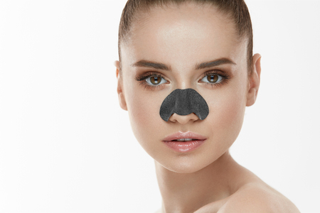Cosmetology. Portrait Of Beautiful Female Model With Black Mask On Nose. Closeup Of Healthy Young Woman With Pure Soft Skin And Fresh Natural Makeup. Beauty And Skin Care Treatment. High Resolution Stock Photo - 78817350