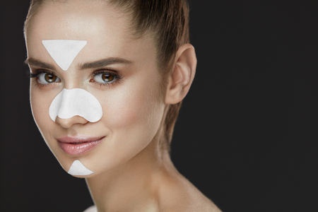 Woman Beauty Face With Mask. Closeup Of Beautiful Young Female With Cleansing Patches For T-Zone On Face. Portrait Of Attractive Sexy Girl Model With Fresh Natural Makeup. Skin Care. High Resolution