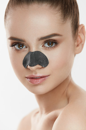 Cosmetology. Portrait Of Beautiful Female Model With Black Mask On Nose. Closeup Of Healthy Young Woman With Pure Soft Skin And Fresh Natural Makeup. Beauty And Skin Care Treatment. High Resolution Stock Photo - 78817403