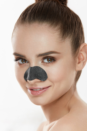 Cosmetology. Portrait Of Beautiful Female Model With Black Mask On Nose. Closeup Of Healthy Young Woman With Pure Soft Skin And Fresh Natural Makeup. Beauty And Skin Care Treatment. High Resolution Stock Photo - 78817409