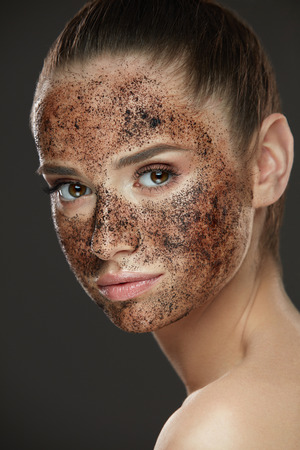 Face Care. Closeup Of Young Woman With Natural Makeup And Coffee Scrub Mask On Fresh Facial Skin. Portrait Of Beautiful Sexy Female Model With Peeling Cosmetic Product On Beauty Face. High Resolution Фото со стока - 78817415
