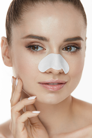Skin Care. Closeup Of Beautiful Woman Beauty Face With White Patch, Pore Strip On Nose. Portrait Of Sexy Girl With Fresh Makeup Touching Clean Soft Pure Facial Skin With Hand. High Resolution Stock Photo - 78817520