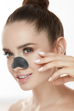Skin Cleaning. Closeup Of Beautiful Young Woman With Black Textile Mask On Nose. Portrait Of Attractive Sexy Girl With Fresh Natural Makeup And Soft Facial Skin Using Nose Patch Strip. High Resolution