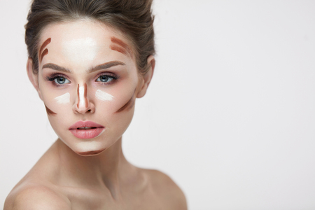Beauty Cosmetics. Portrait Of Beautiful Sexy Female With Contouring And Highlighting Lines On Facial Skin. Closeup Of Attractive Young Woman With Fresh Natural Makeup Contour Lines. High Resolution Stock fotó
