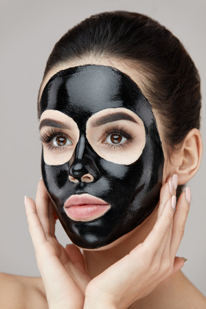 Woman Beauty Face Skin Care. Closeup Of Attractive Girl Applying Black Smooth Peeling Mask On Facial Skin. Portrait Of Beautiful Female With Natural Makeup And  Cosmetic Peel Off Mask. High Resolution Stock Photo - 81438287
