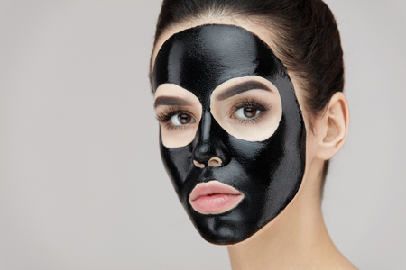 Beauty Face Cosmetics. Closeup Of Young Female With Natural Makeup And Black Peel Off Mask On Facial Skin. Portrait Of Attractive Woman With Cosmetic Peeling Product On Beautiful Face. High Resolution Stock Photo - 81438246