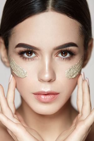 Beauty Skin Cosmetics. Portrait Of Gorgeous Sexy Young Woman With Stripes Of Cosmetic Scrub On Face. Closeup Beautiful Healthy Girl With Natural Makeup And Peeling Mask On Soft Skin. High Resolution