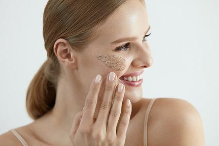 Face Skin Scrub. Portrait Of Beautiful Smiling Female Applying Cosmetic Mask, Face Scrub On Facial Skin. High Resolution Stock Photo - 84130208