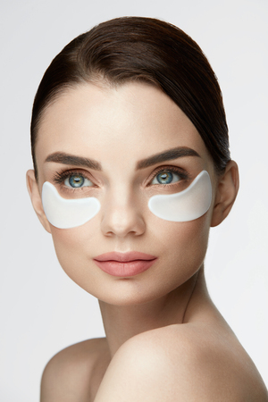 undereye: Eye Skin Mask. Portrait Of Beautiful Young Female Model With White Under Eye Skin Patches, Skin Care Product On Beauty Face. High Resolution Stock Photo