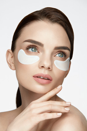 Eye Skin Beauty. Closeup Of Beautiful Young Woman Face With Natural Makeup, Healthy Fresh Skin And Collagen Hydrogel Eye Patches Under Eyes. High Resolution