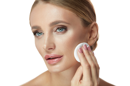 Clean Skin. Portrait Of Sexy Girl With Cotton Pads Removing Make-Up From Face. Closeup Beautiful Female Model With Fresh Glamour Natural Makeup Cleaning Facial Skin With Cosmetic Pad. High Resolution