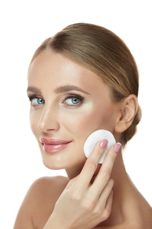 Clean Skin. Portrait Of Sexy Smiling Girl With Cotton Pads Removing Make-Up From Face. Closeup Beautiful Happy Female Model With Fresh Natural Makeup Cleaning Facial Skin. Cosmetics. High Resolution