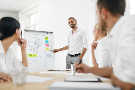 Team Meeting. Business Training With Employees In Office. Successful Businessman Making Presentation For His Colleagues, Explaining Business Plan. People Meeting. High Resolution. Standard-Bild - 91511080