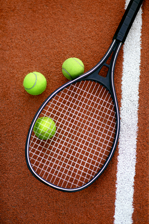 Sport. Tennis Balls And Racket On Court. Close Up Of Equipment For Sports Such As Tennis Racquet And Yellow Ball Lying On Open Court. High Quality Banque d'images