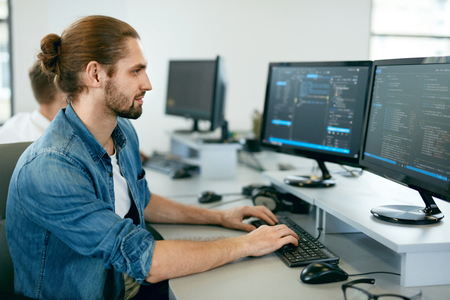Programming. Man Working On Computer In IT Office, Sitting At Desk Writing Codes. Programmer Typing Data Code, Working On Project In Software Development Company. High Quality Image. Standard-Bild