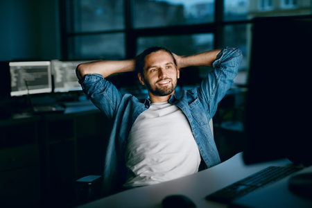 Programming. Man Working On Computer In IT Office. Handsome Young Male Programmer Sitting In Dark,  Working On Project In Software Development Company. High Quality Image.