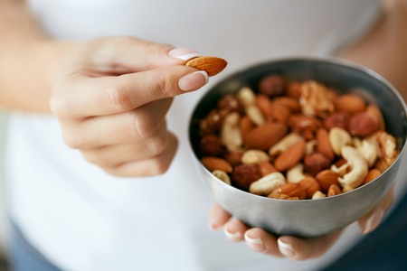 Healthy Food. Hands Holding Bowl With Nuts