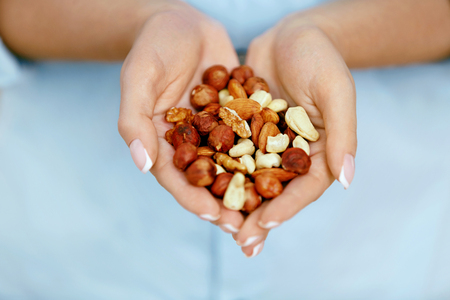 Nuts In Hands. Woman Hands Holding Healthy Food