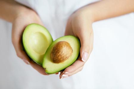 Healthy Food. Avocado In Woman Hands