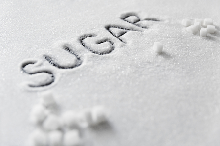 Sugar Word. White Sugar On Background. Close Up Of White Refined Sugar Inscription On Table. High Quality