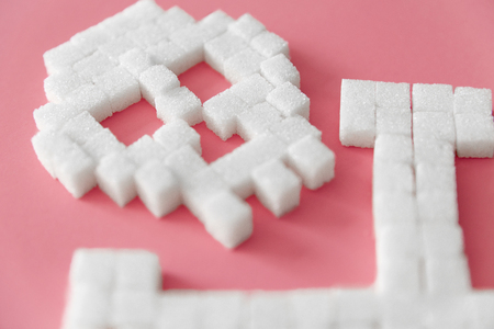 White Sugar Cubes In Form Of Skull. Close Up Of Refined Sugar On Pink Background. Deadly Sugar Addiction. Diabetes And Death Concept. High Quality Imagens - 96944214