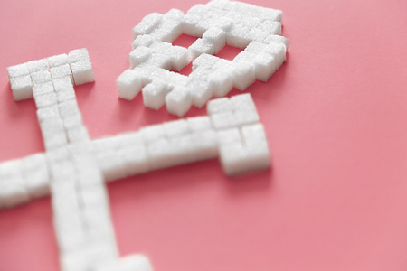 White Sugar Cubes In Form Of Skull. Close Up Of Refined Sugar On Pink Background. Deadly Sugar Addiction. Diabetes And Death Concept. High Quality