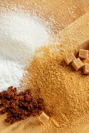 Sugar. White Sugar And Brown Sugar On Wood Background. Close Up Of Sugar Cubes And Granulated Sugar Lying On Wooden Table. High Quality Image. Imagens - 96944355