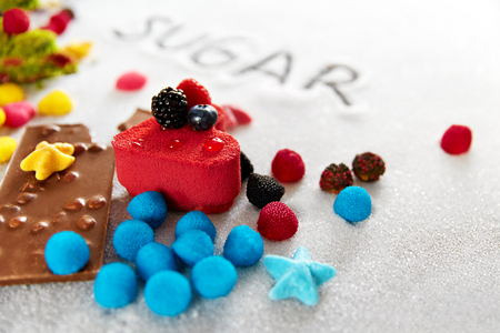 Sugar And Colorful Sweets On Table. Sweet Cakes, Candies, Chocolate And Inscription Sugar Writing In Sugar Grains. High Quality Image