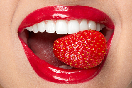 Lips. Woman With Red Lipstick And Strawberry. Close Up Of Plump Full Sexy Lips With Professional Lip Makeup Holding Berry In White Healthy Teeth. Beauty And Cosmetics Concept. High Resolution Stok Fotoğraf - 97762957