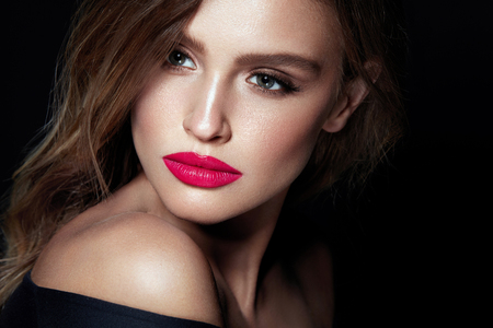 Beauty Makeup. Woman With Beautiful Face And Pink Lips. Close Up Of Beautiful Young Elegant Female Model With Glamorous Sexy Makeup, Soft Smooth Skin And Plump Full Pink Lips. High Quality Image. Stock Photo