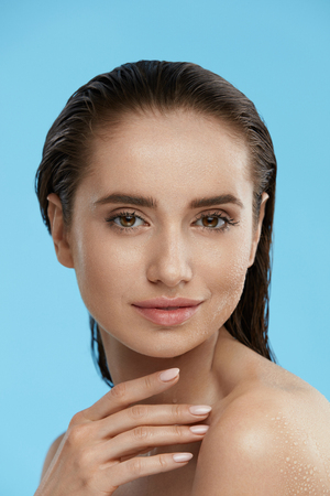 Beauty Face. Beautiful Woman With Healthy Wet Skin And Fresh Natural Facial Makeup. High Quality