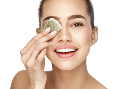 Eye Skin Care. Beautiful Woman With Green Tea Bag Under Eyes On White Background. High Resolution.