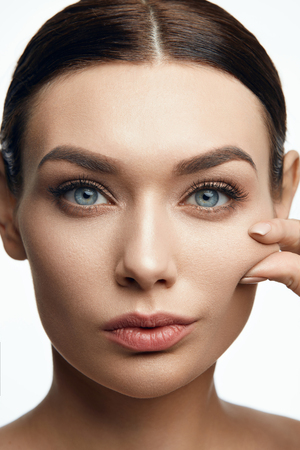 Healthy Skin. Beautiful Woman With Beauty Face Pulling Elastic Facial Skin. High Resolution. Stock Photo