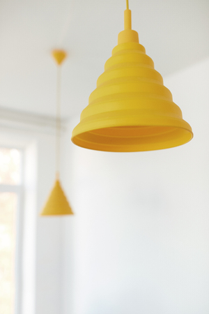Modern Yellow Chandeliers Hanging On Ceiling