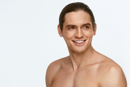 Men Face Care. Beauty Man Face With Smooth Shaved Skin On White Background. High Resolution.