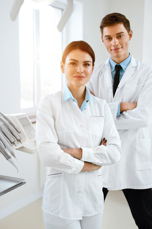 Young Dental Doctors Working At Workplace In Dentistry Clinic. High Resolution. Stock Photo