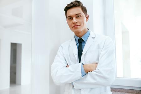 Male Dentist Doctor In Dental Clinic. Portrait Of Happy Dentistry Doctor Wearing White Coat. High Resolution. Stok Fotoğraf