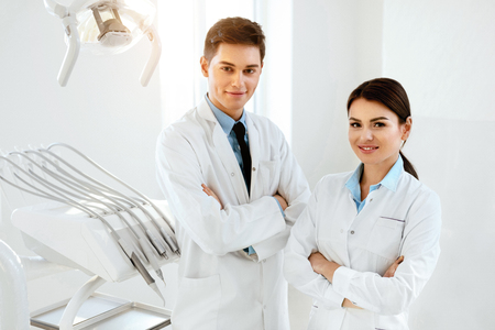 Young Dental Doctors Working At Workplace In Dentistry Clinic. High Resolution. Stok Fotoğraf