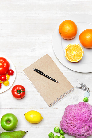 Nutrition Diet. Fresh Vegetables, Fruits And Notebook With Pen Lying On White Table. High Resolution.