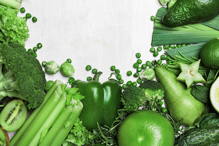 Organic Green Vegetables On White Wooden Background. High Resolution.