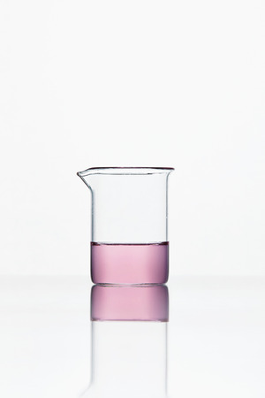 Laboratory Glassware. Transparent Glass With Pink Chemical Liquid On White Background. High Resolution.